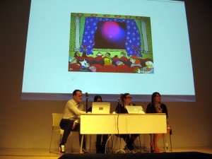 "Panel discussion of Theresa Duncan's CD-ROMs with a scene from ""Smarty"" on-screen. (from left to right) Rhizome archivist Dragan Espenchied, Participant Inc. founder Lia Gangitano, game critic Jenn Frank, FEMICOM Museum founder Rachel Simone Weil."
