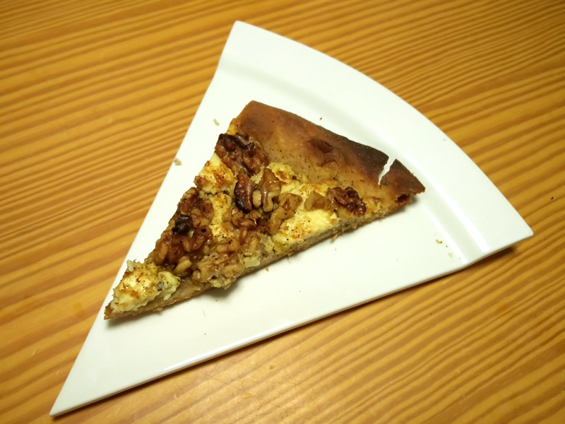 Picture of a slice of Gorgonzola and walnut pizza