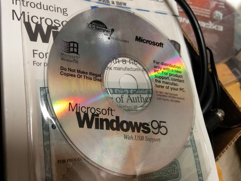"A CD-ROM labeled ""Microsoft Windows 95 with USB Support CD."" The CD also says ""Do Not Make Illegal Copies Of This Disc"""