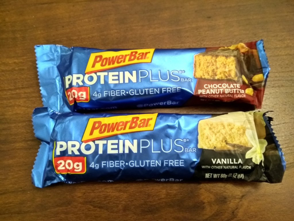 Two ProteinPlus PowerBars, one chocolate peanut butter and one vanilla