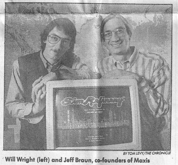 Will Wright and Jeff Braun pose with a computer running SimRefinery.