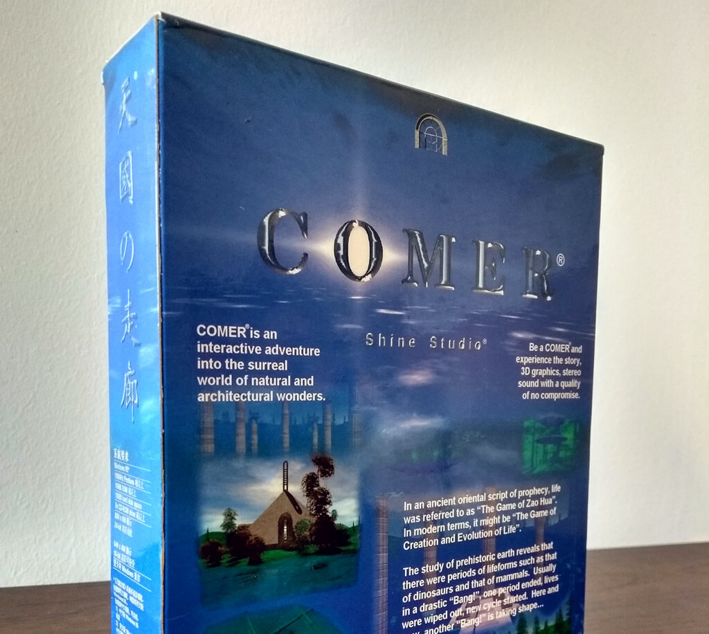 "The box for Comer by Shine Studio. The front of the box reads: ""COMER is an interactive adventure into the surreal world of natural and architectural wonders. Be a COMER and experience the story, 3D graphics, stereo sound with a quality of no compromise. In an ancient oriental script of prophecy, life was referred to as 'The Game of Zao Hua.' In modern terms, it might be 'The Game of Creation and Evolution of Life.' The study of prehistoric earth reveals that there were periods of lifeforms such as that of dinosaurs and that of mammals. Usually in a drastic 'Bang!', one period ended, lives were wiped out, new cycle started. Here and now, another 'Bang!' is taking shape..."""