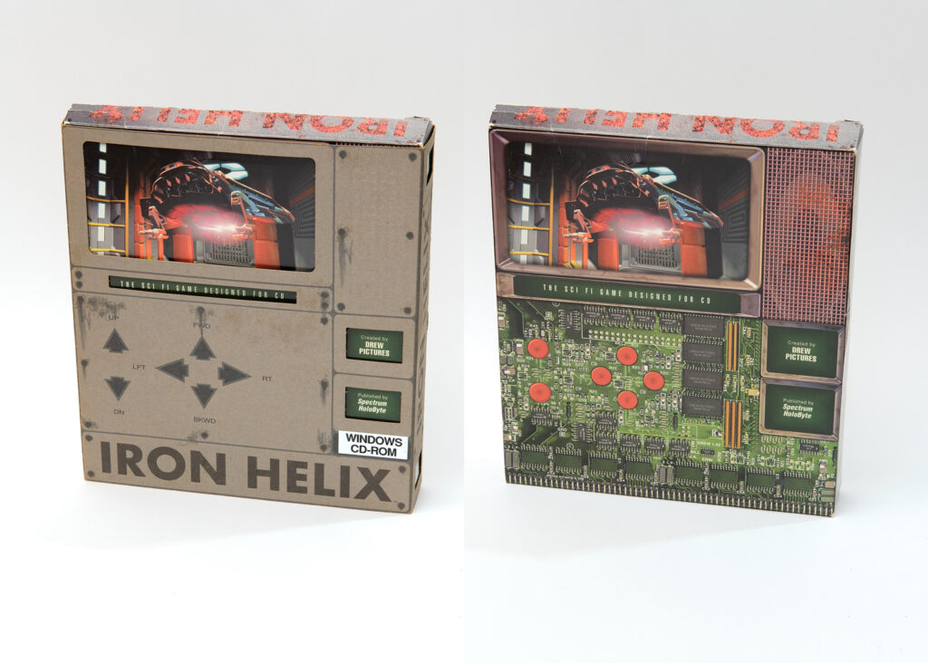 The box for Iron Helix. It resembles an old handheld computer with a small screen and large buttons. The box has a removeable sleeve, and underneath, it resembles an exposed circuit board.