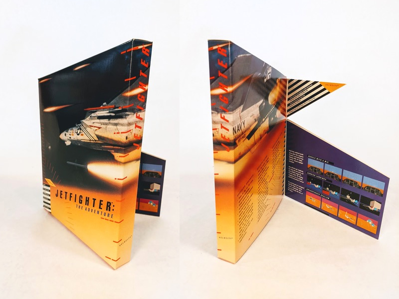 The box for JetFighter: The Adventure. Rather than being flat, the top of the box rises up at slight angle. On the back of the box, two flaps fold out, loosely evoking the features of a fighter jet.