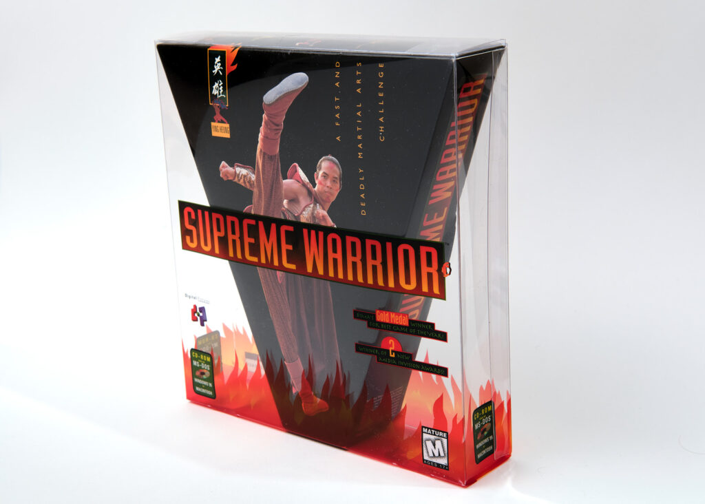 The box for Supreme Warrior. There is a black triangular box featuring a picture of the villain, Fang Tu, played by Ron Yuan. The triangular box is contained within a transparent rectangular box, which features the game's logo. Together, they create one cohesive packaging image.